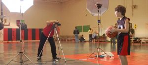 Professional photographer at sports photo session
