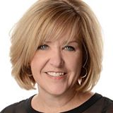 head shot of Joan Hollander - blonde with a bob hair cut - an owner of a TSS Photography Franchise