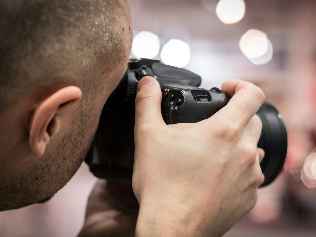 Man with camera taking photo for photography franchise business