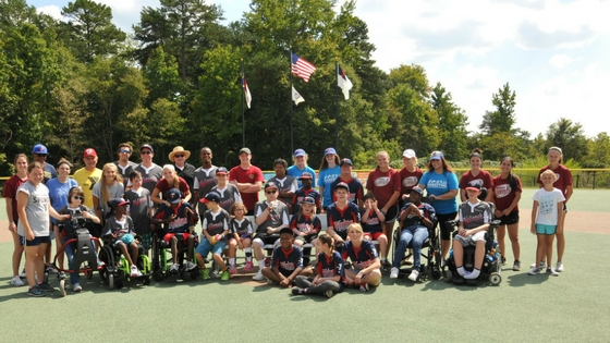 teams from The Miracle League including players and buddies that TSS Photography franchise owner volunteers with by taking their sports photography photos