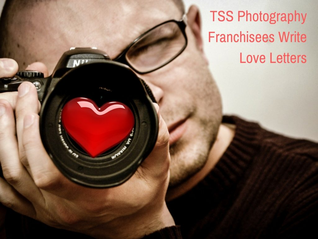 Man with camera to represent TSS Photography franchisees love for their job.