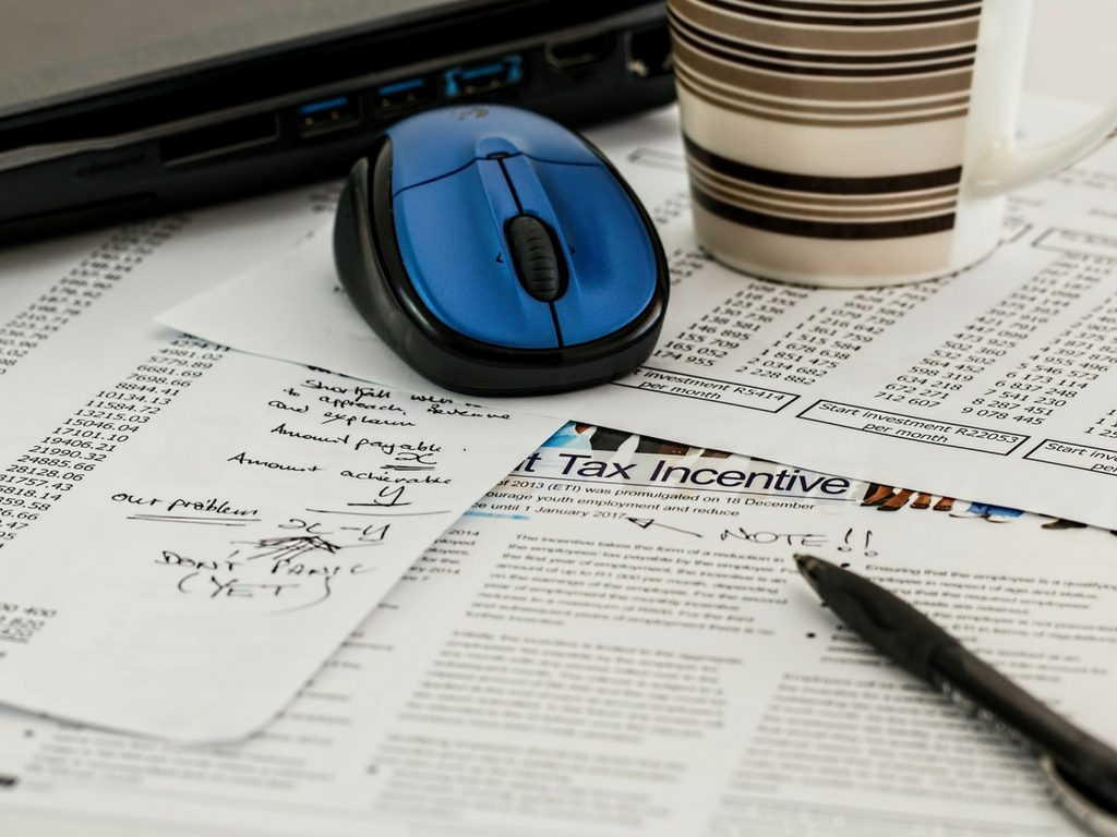 a header image showing tax paperwork portraying incentive to think about purchasing a franchise