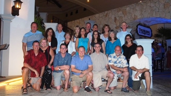 A group of casually dressed TSS Photography franchise owners posing while in Playa Del Carmen