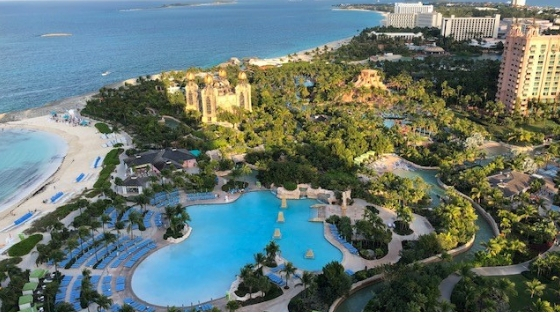 The President's Club hotel vacation resort in the Bahamas, showing the lagoon and the island with hills, trees and magical looking blue water