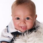 Close-up Portrait of Baby by TSS Franchisee