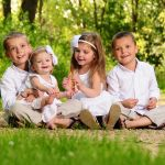 Four Kids Seated for Family Photo